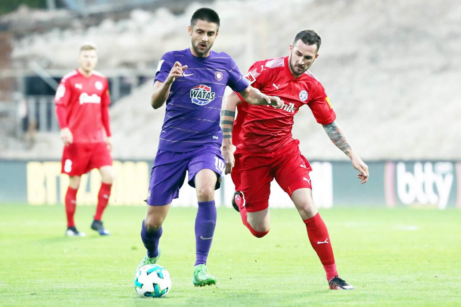 Behauptet sich Dimitrij Nazarov gegen Dominik Schmidt? Jetzt auf Aue gegen Kiel wetten.