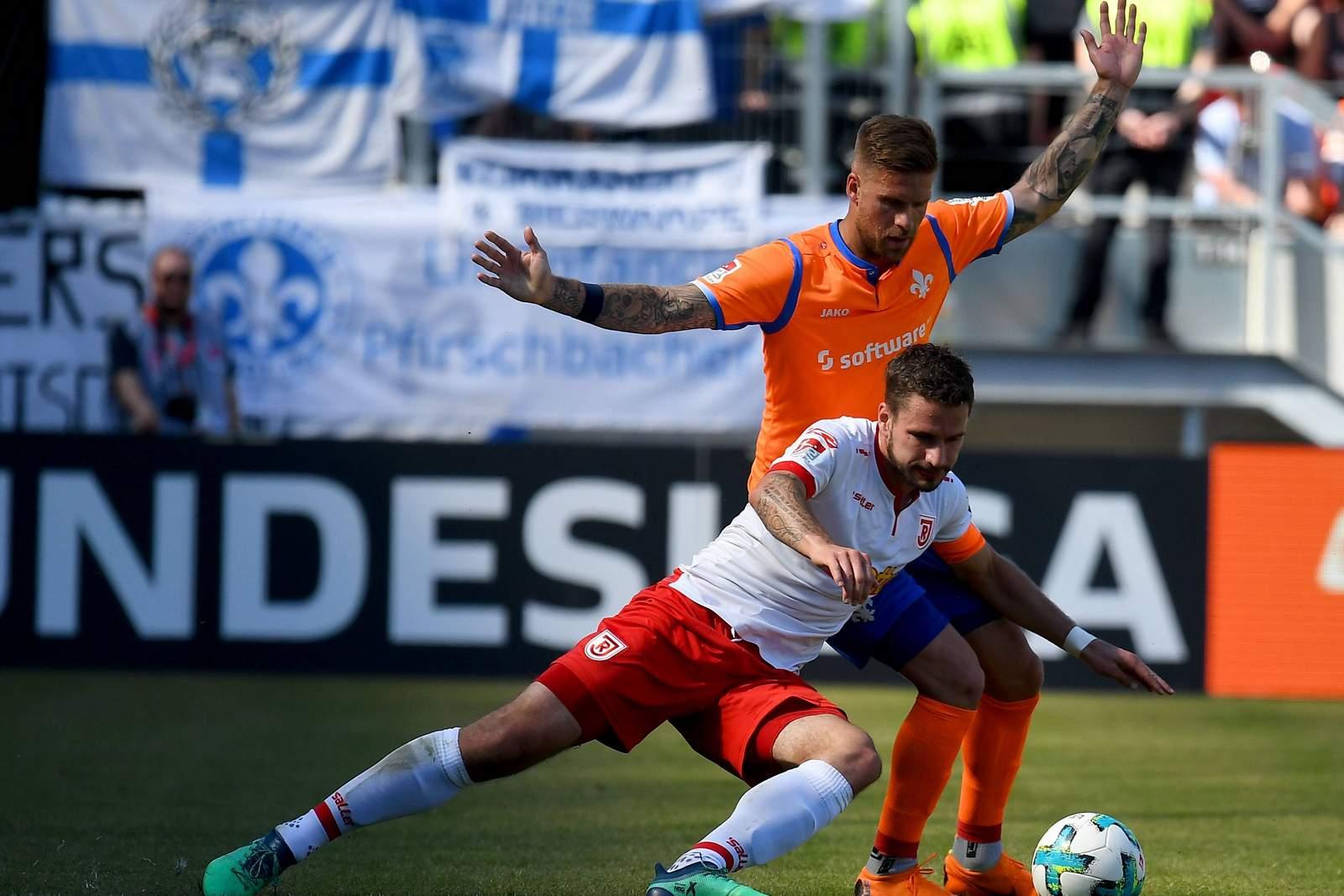 Zeigt Marco Grüttner im Duell mit Tobias kempe mehr Durchsetzungskraft? Jetzt auf Jahn Regensburg gegen Darmstadt 98 wetten.