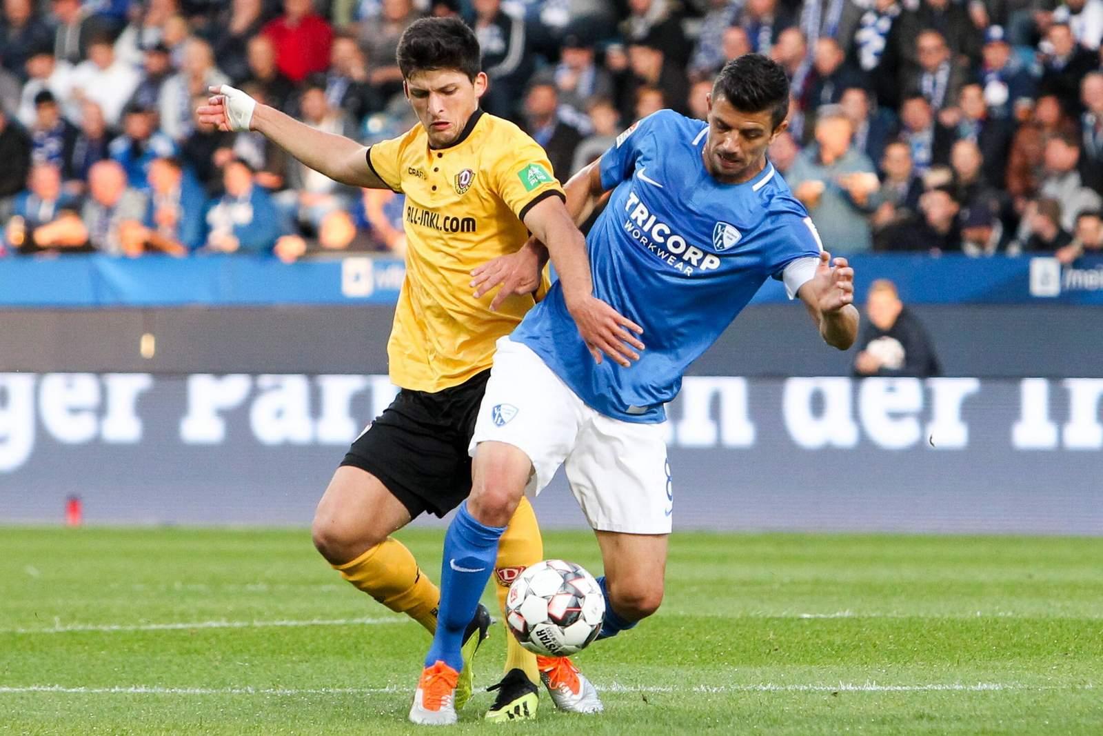Anthony Losilla vom VfL Bochum gegen Jannis Nikolaou von Dynamo Dresden