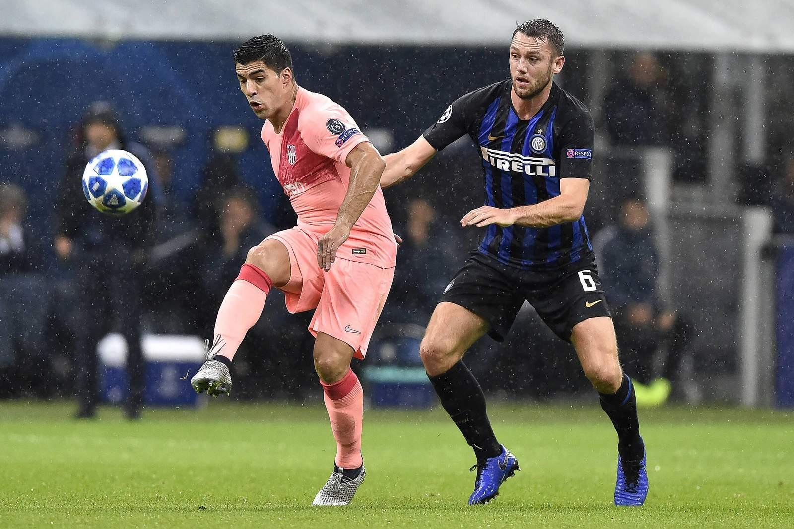 Hält die Serie der Katalanen um Luis Suarez (l.)? Jetzt auf Barcelona gegen Inter wetten!