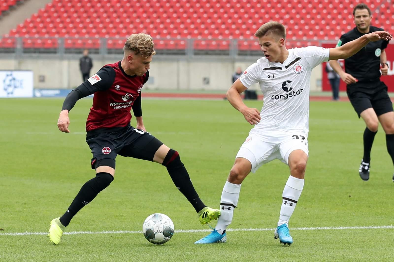 Robin Hack gegen Finn Ole Becker. Jetzt auf FC St. Pauli vs 1. FC Nürnberg wetten